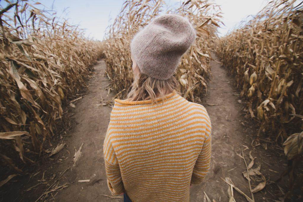 woman entering a maze