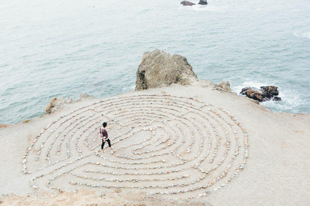 women navigating a maze on a beach